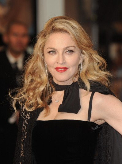 "01/11/2012 - Madonna - ""W.E."" UK Premiere - Arrivals - The Odeon, Kensington - London, UK - Keywords: headshot, black spaghetti strap full length maxi dress, necklace, pendant, black scarf, diamond hanging earrings, diamond earrings, jewelry, long wavy blonde hair, Material Girl Orientation: Portrait Face Count: 1 - False - Photo Credit: Solarpix / PR Photos - Contact (1-866-551-7827) - Portrait Face Count: 1"