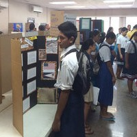 Students touring classrooms and viewing the projects of their peers.