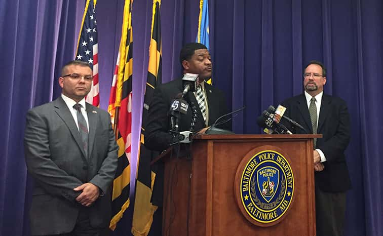 From WBAL NewsRadio 1090 Robert Lang: Baltimore City Police spokesman TJ Smith (center) speaks at a news conference. To his left is Chief of Homeland Security for Baltimore Police Marcos Zarragoitia. To his right is Ross McNutt, President of Persistent Surveillance Systems.
