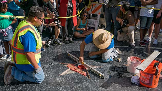 Workers repair Donald Trump's damaged Hollywood Walk of Fame star; AaronP/Bauer-Griffin/GC Images