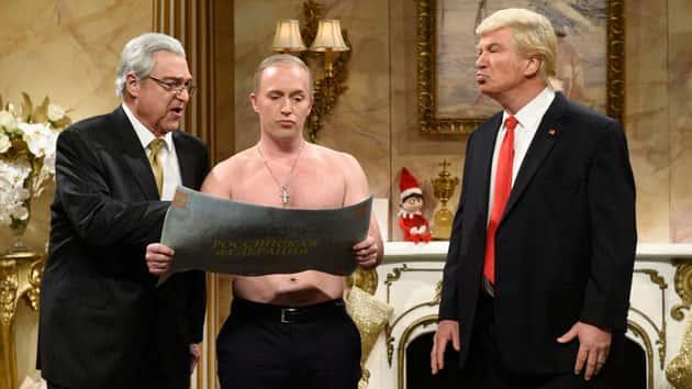LR: John Goodman as Rex Tillerson, Beck Bennett as Russian President Vladimir Putin, and Alec Baldwin as Donald Trump; Will Heath/NBC