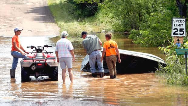 T07.12.2016 -- Steve Kuchera -- kucheraFLOOD0713c1 --  Mark Jolma retrieves a boat from flood waters in Marengo on Tuesday. Jolma was going to use the boat to reach his farm, which was cut off by water over the surrounding roads. Steve Kuchera / skuchera@duluthnews.com
