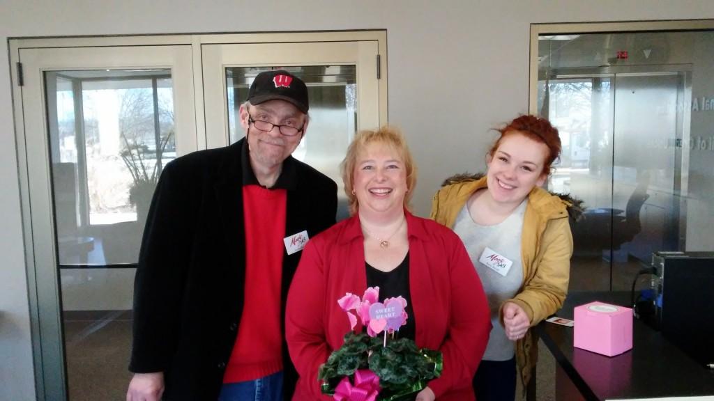Jim, Carla Leuzinger, and Raina at CUNA Mutual