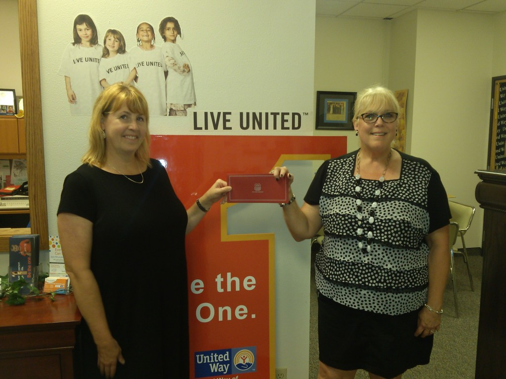 Kelli O'Brien, Director of Public Affairs for Union Pacific, presenting a $5,000 corporate donation to Steph Black, Executive Director of United Way of Western NE. to kick off the 2016-17 United Way Campaign.