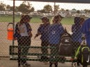 Members of the Gering softball team wait in the dugout during Tuesday night's lightning delay in Alliance.