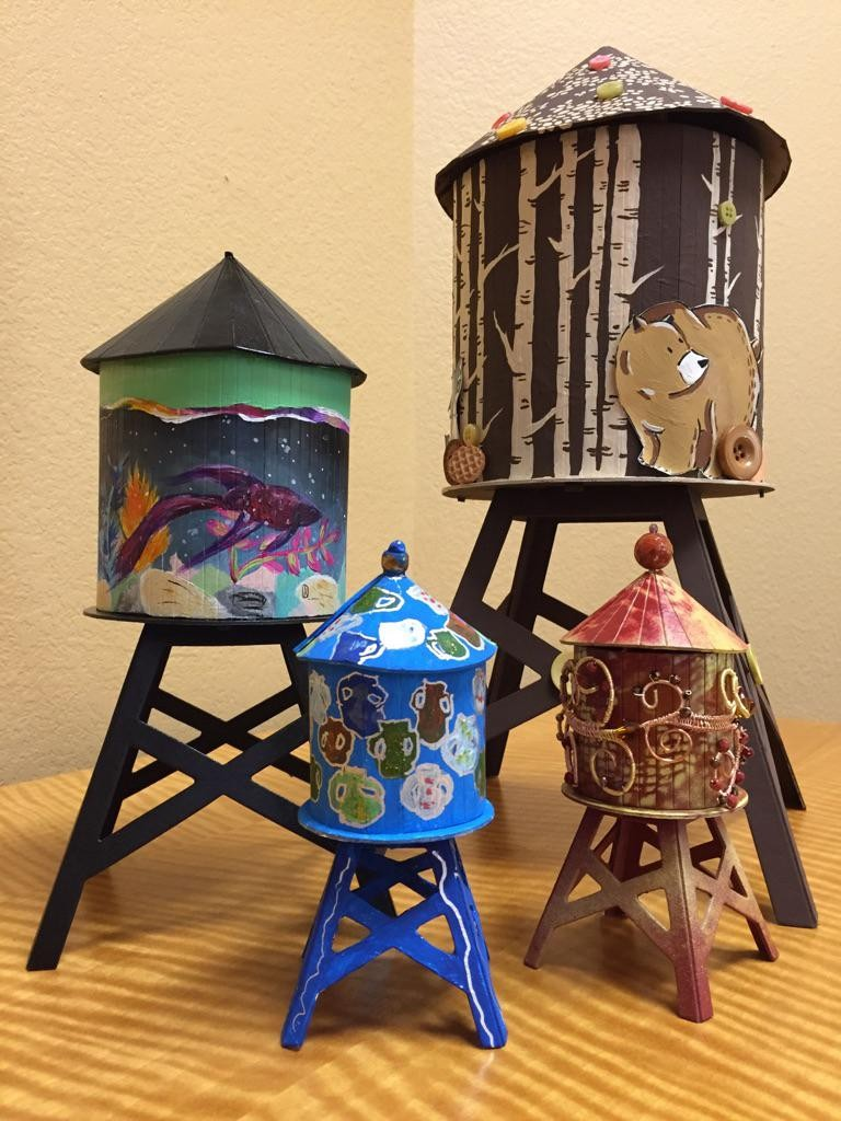 A silent auction of 15 miniature water towers uniquely designed by area artists takes place during the Business After Hours on Oct. 20.