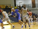 Michael Connor Jr. dribbles the ball against Lamar Community College (Photo Courtesy of Mark Rein)