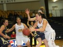Olivia Wiberg drives to the basket against LCCC. (Photo Courtesy of Mark Rein)