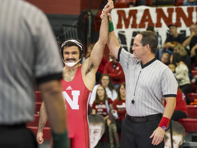 Dustin Williams (165) earned his first pin of the season. (Photo Courtesy of Scott Bruhn/Nebraska Communications)