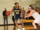 Anastacia Johnson sets the offense against EWC on Saturday night in Torrington. (Photo Courtesy of Mark Rein)
