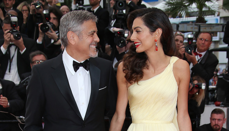 Amal Clooney, right, and George Clooney pose for photographers upon arrival for the screening of the film Money Monster at the 69th international film festival, Cannes, southern France, Thursday, May 12, 2016. (AP Photo/Joel Ryan)