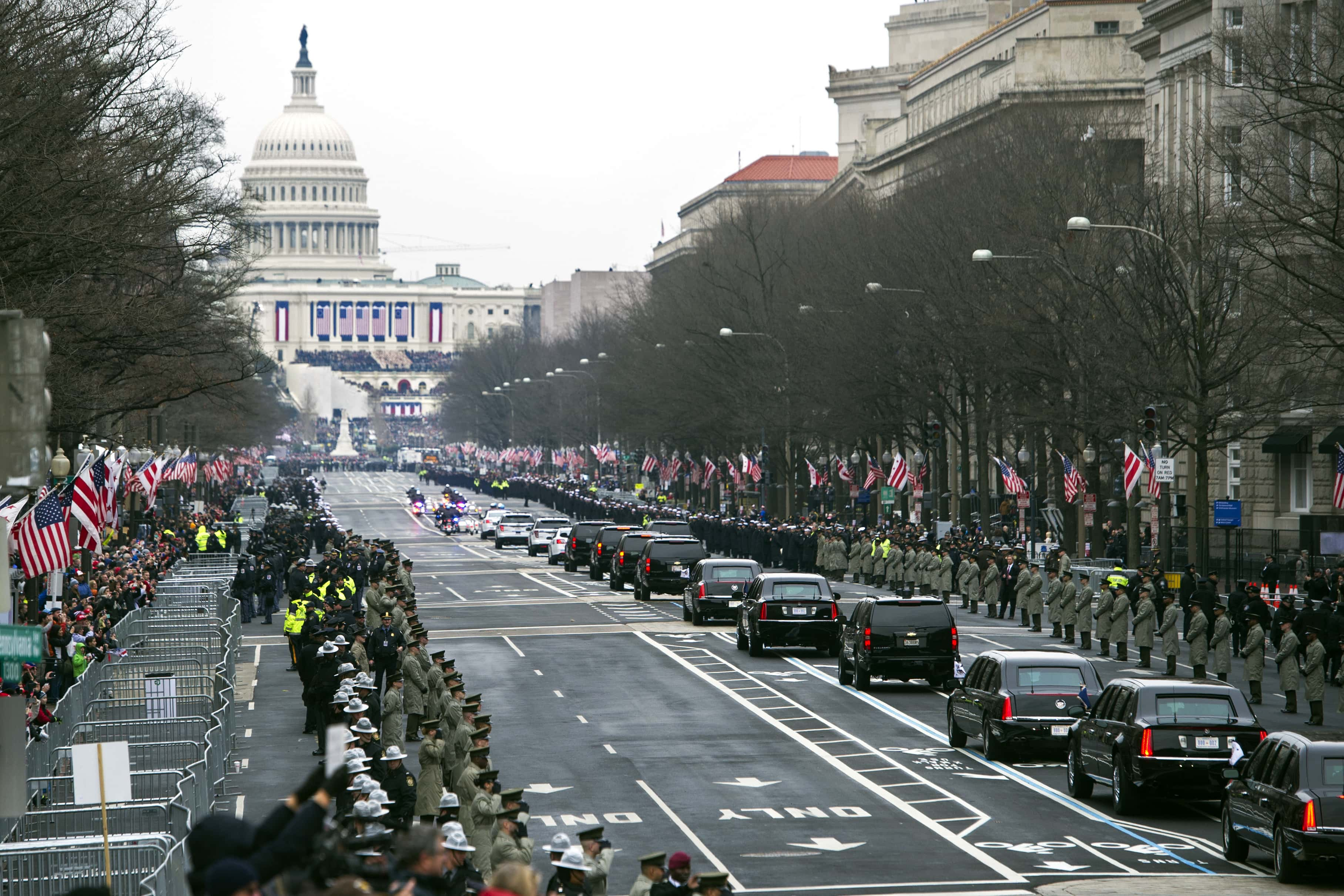 The Presidential motorcade drives on Pennsylvania Avenue to the Capitol for the Inauguration of President-elect Donald Trump, Friday, Jan. 20, 2017, in Washington. (AP Photo/Cliff Owen)