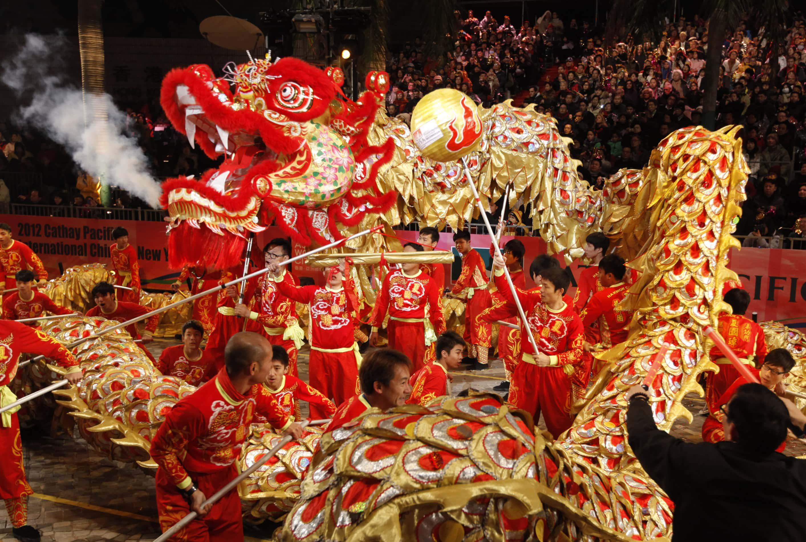 Performers take part in a dragon dance in a night parade in Hong Kong Monday, Jan. 23, 2012, celebrating the start of the Chinese Lunar New Year. According to the Chinese zodiac, the year 2012 is called the Year of the Dragon. (AP Photo/Vincent Yu)