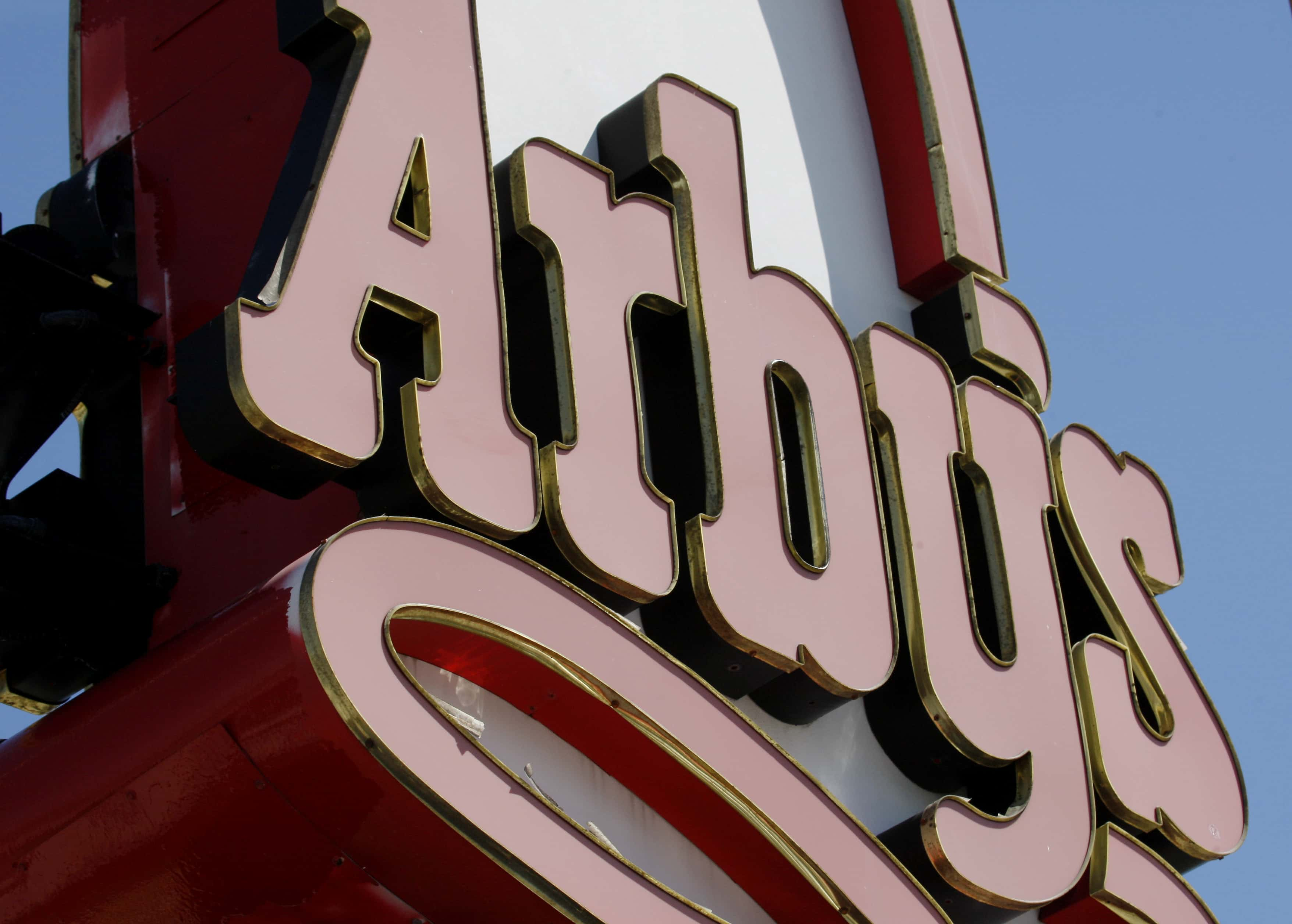 FILE - In this Monday, March 1, 2010 file photo, an Arby's restaurant sign is shown in Cutler Bay, Fla. Wendy's/Arby's Group Inc. said Thursday, Jan. 20, 2011, it is considering selling its Arby's business. (AP Photo/Wilfredo Lee, file)