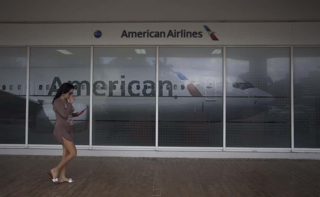 A woman walks past the new American Airlines' office in Havana, Cuba, Monday, Jan. 30, 2017. (AP Photo/Desmond Boylan)