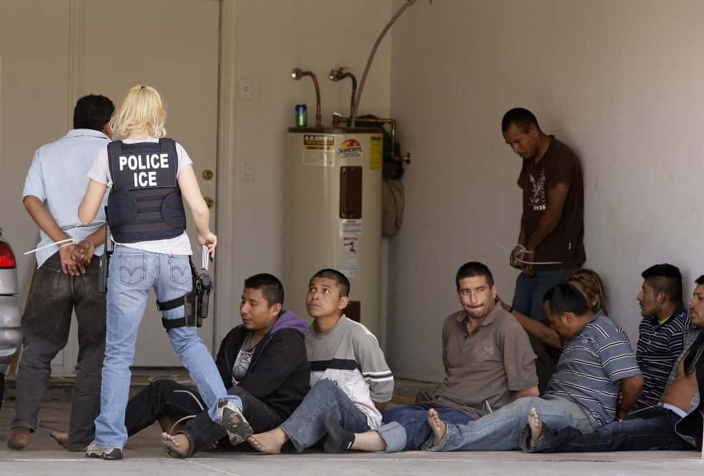 While the new Arizona immigration law drew protests, news conferences and court lawsuits, a drop house was raided by the Arizona Department of Public Safety along with other law enforcement jurisdictions including U.S. Immigration and Customs Enforcement, yielding nine suspected illegal immigrants, shown here, and three suspected human smugglers Thursday, April 29, 2010, in Phoenix. (AP Photo/Ross D. Franklin)