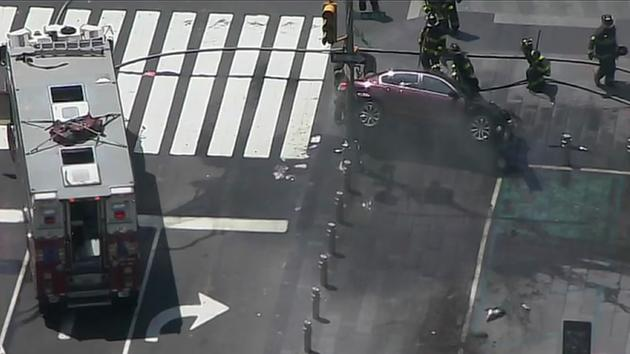 Auto drives wrong way in Times Square and hits crowds; 1 dead