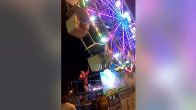 Fair worker falls from malfunctioning Ferris wheel while making repairs