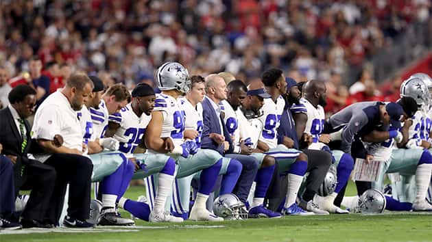Cowboys Players, Owner Jerry Jones Link Arms and Kneel Before National Anthem