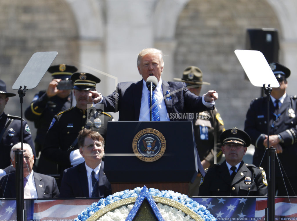 The Latest: Trump pays tribute to fallen police officers ...