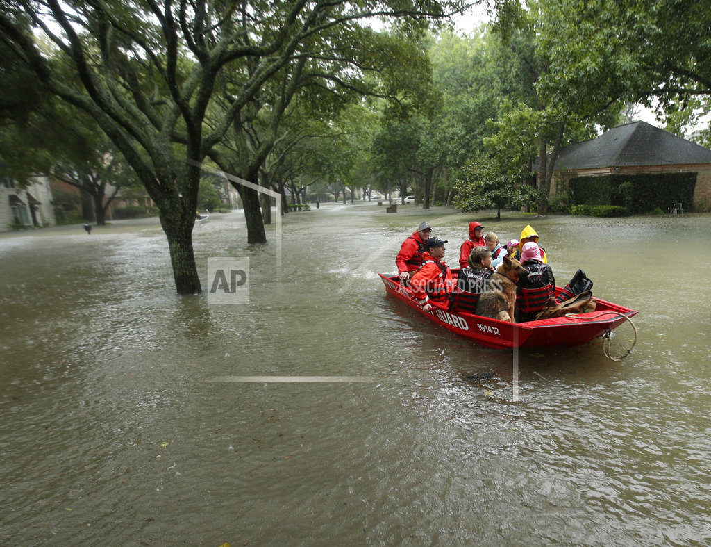 Houston endures more rain and chaos; 6 feared drowned in van