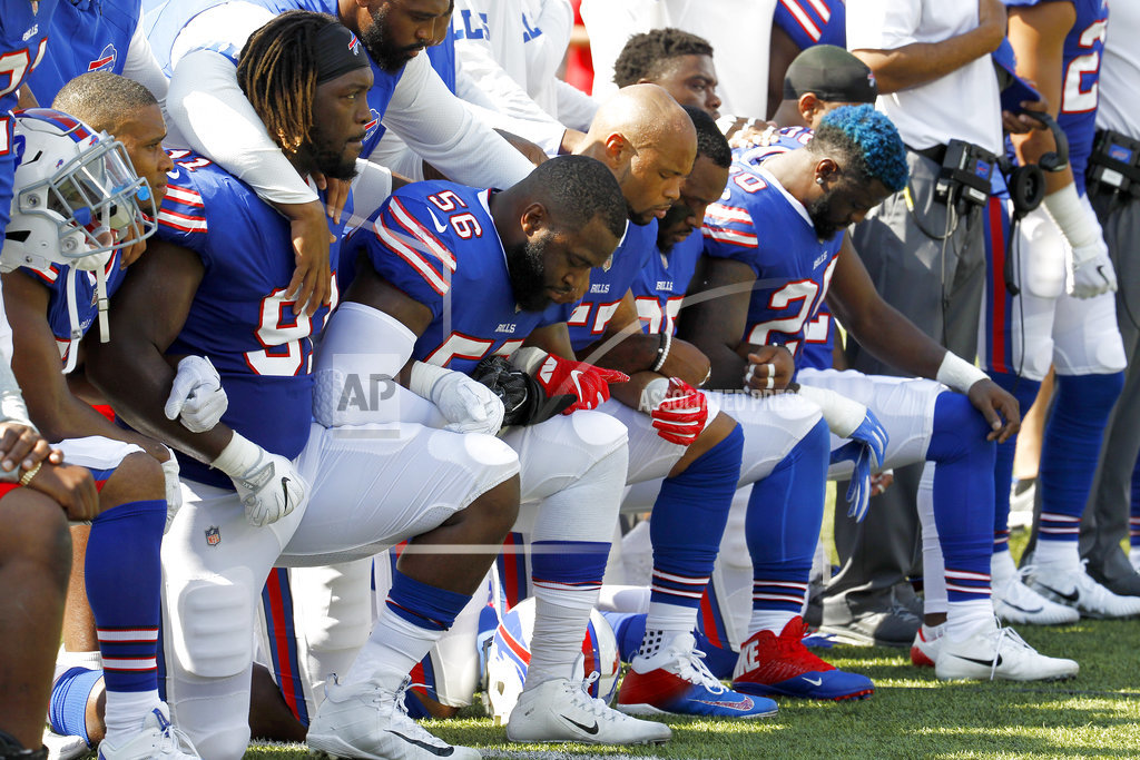 Several Ravens, Jags kneel during anthem
