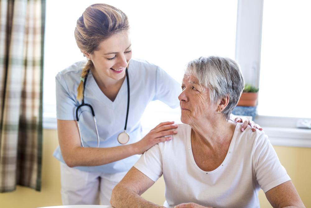 Nurse examining senior with Alzheimer's disease.