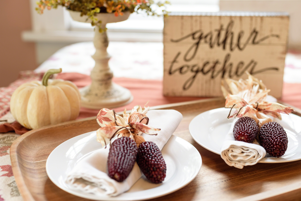 Dinner plates decorated in a festive fall theme.