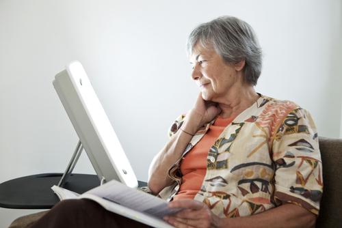 Elderly woman reading.