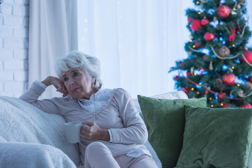 Elderly woman experiencing Seasonal Affective Disorder during Christmas.