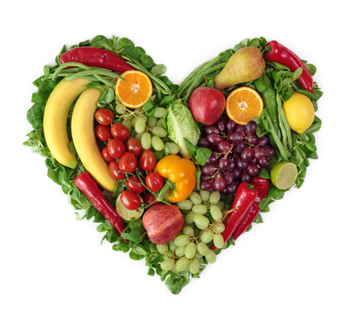Healthy fruits and vegetables placed in the shape of a heart.