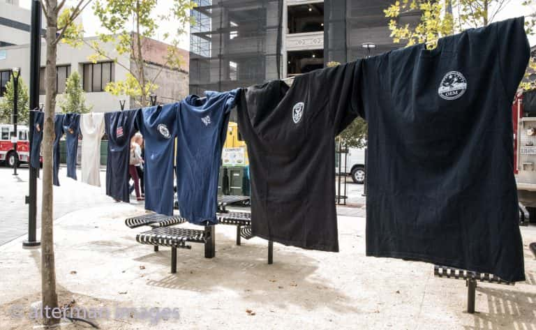 Just a small portion of the fire department t-shirts hung around the square.
