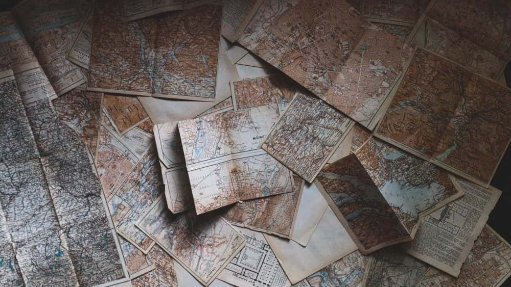 pile of maps on table, planning and goals new year 2019 business