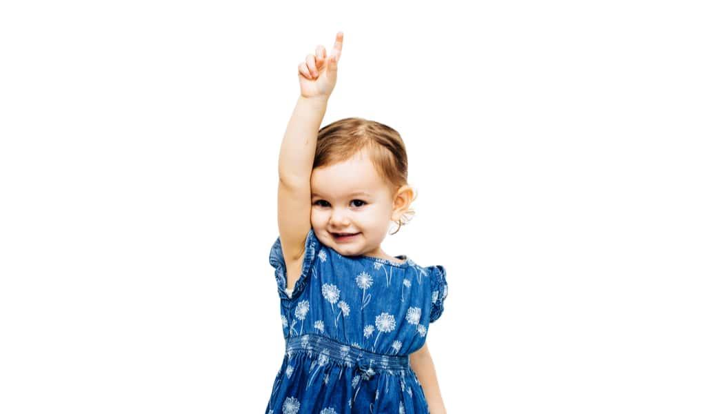 little girl raising hand to talk