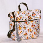 Nash_Floral: Floral Print white leather backpack style purse. Optional Tote straps.