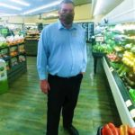 The Supermarket Superstar Patrick Healy doing his daily walk-arounds in the store: Patrick Healy is an exemplar grocery manager at a local Safeway store in Tucson. Everyday, he puts 110% into his job. He deals with many social issues (especially right now). Many people are not used to the changes in supermarkets and other retail stores. However, Patrick puts his professionalism first and assists with all customer needs and goes above and beyond. Patrick is a very respectable grocery manager. Managing dozens of people on staff can be difficult. However, Patrick is very caring and understanding with his all of his staff at his store. He builds meaningful relationships and really cares about their stories. On top of that, he gets the job done. He and other grocery store employees NEED and SHOULD be recognized for their help and support other the past three months. They put their lives at stake to help us all have the essentials we need. Patrick is one of these people. His family is so very proud of him.