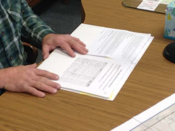 Petition with some 70 signatures opposing he proposed wind farm.