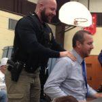 Sean Hagen & Josh Johnson.: School Resource Officer restrains Johnson after he attempted to run away.