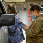 021521-_DSC1709: Senior Airman Rachael McGrady, 119th Force Support Squadron, reviews a patient