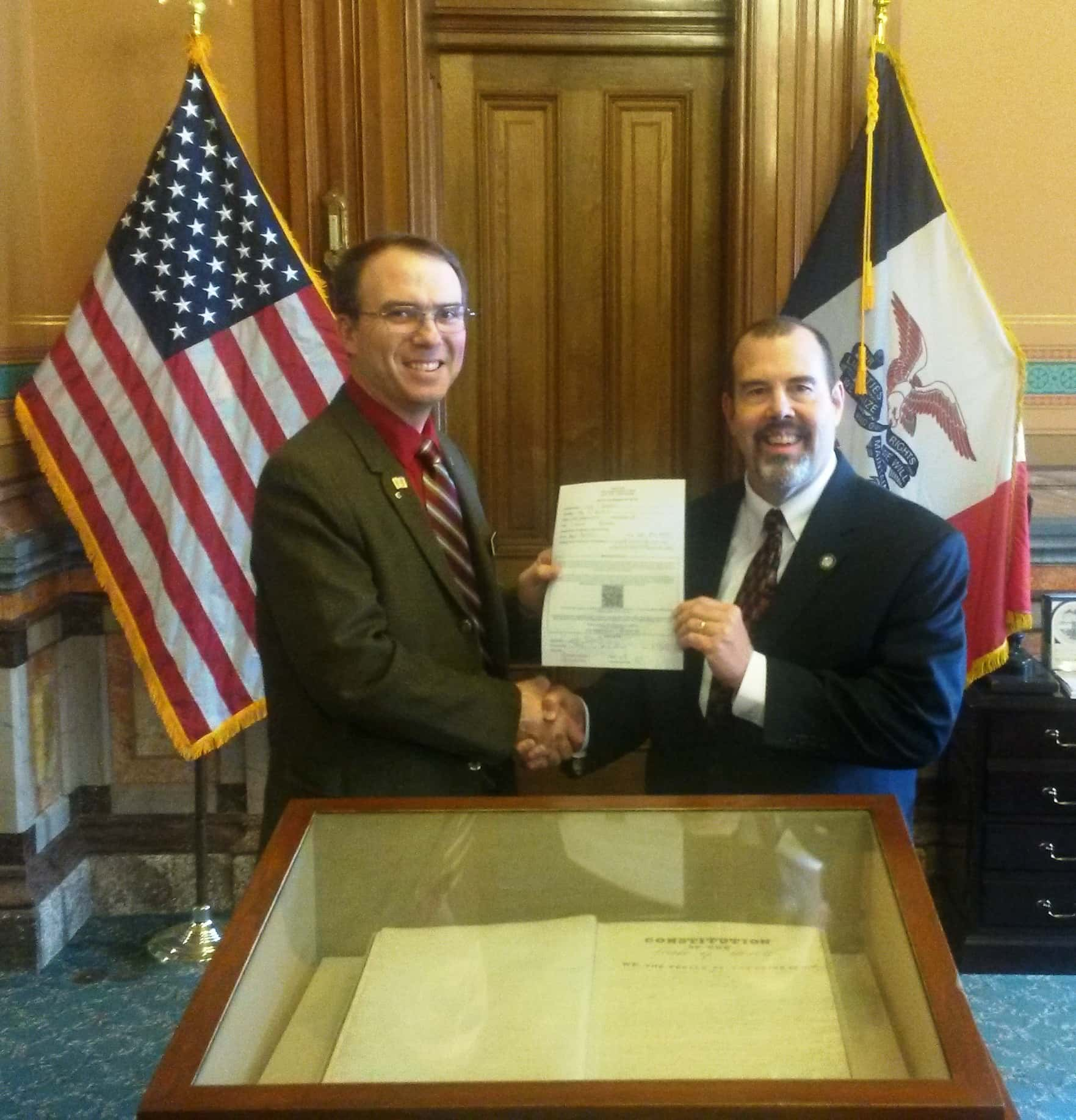 Representative Heartsill  handing his Affidavit of Candidacy paperwork to Deputy Secretary of State Michael Ross.