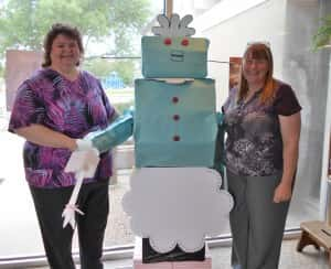 Library Director Jane Millard (left) stands with Rosie from The Jetsons (middle) and Children's Librarian Terry Clark (right)