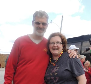 ISU football coach Paul Rhodes greets Paton-Churdan Principal Annie Smith during Tuesday's Tailgate Tour event in Paton. A number of P-C students were on hand.