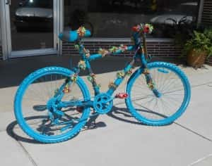Yarn bombed bike in front of Fudge's Flowers and Gifts