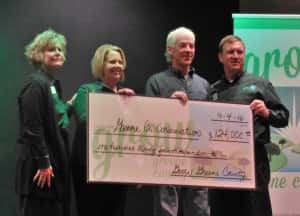 Conservation Director Dan Towers (2nd from right) receives check for project