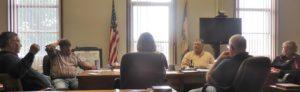 EMS Co-Owner Dennis Morlan (left) speaking to Board of Supervisors