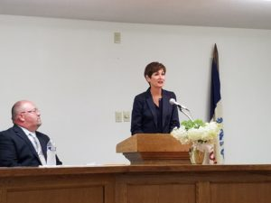Governor Kim Reynolds (right) addresses attendees in Woodward alongside Mayor Brian Devick (left)