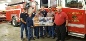 Members of the Perry Firefighters Association receive a check from Monsanto Corporation; photo courtesy of the Perry Fire Department