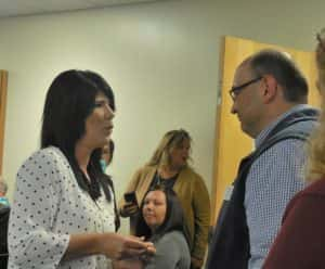 Nicole Steffens (left) pinning Mike Ewalt (right) during veterans pinning ceremony