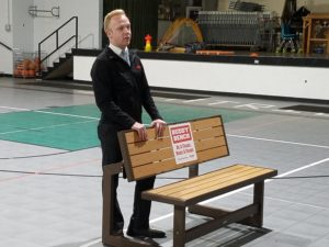"""Hy-Vee Assistant Manager Seth Fridley with the St. Pat's """"Buddy Bench"""""""