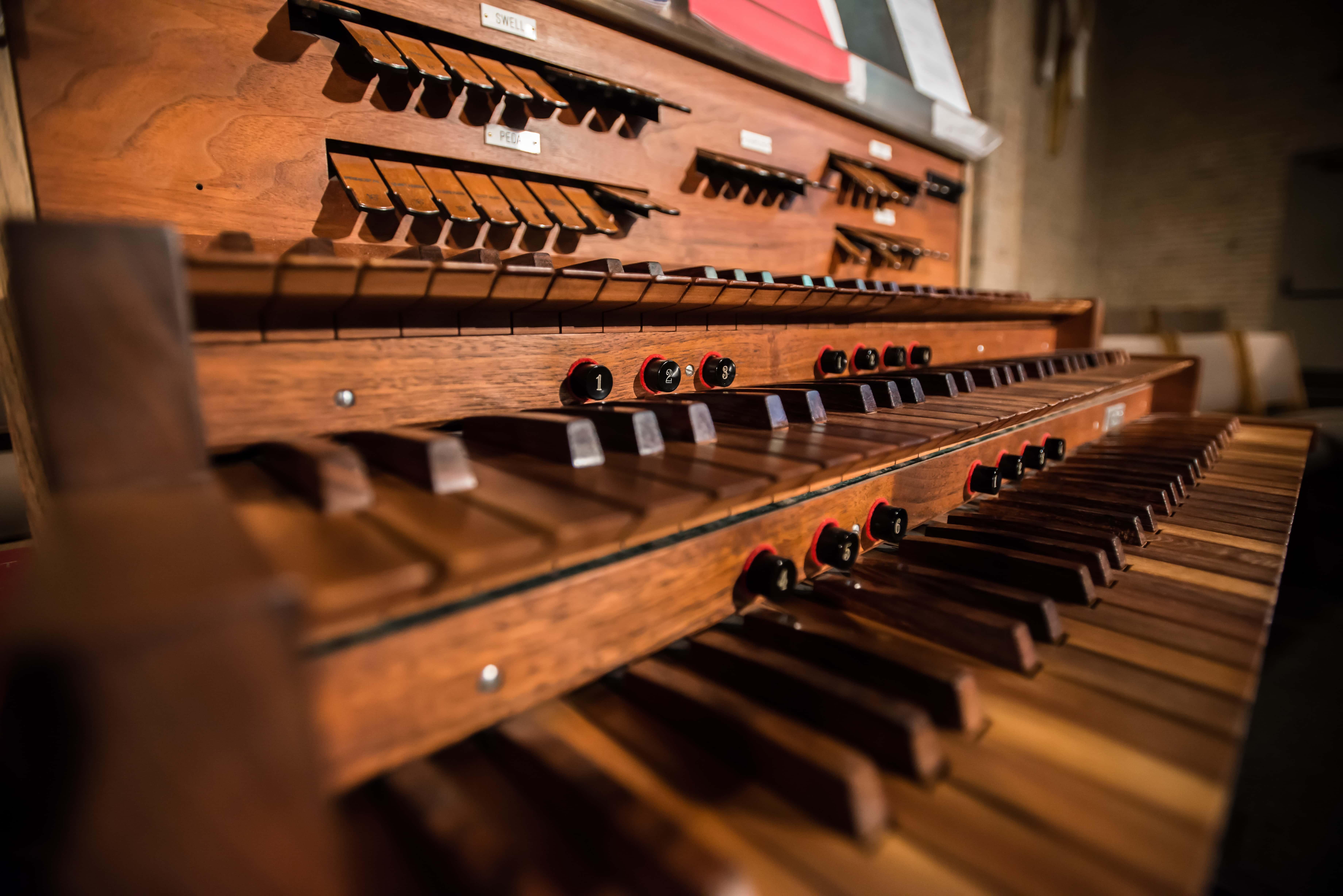 Close-up of wooden keys on organ